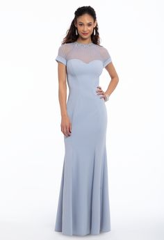 Keep it fresh in this spring wedding guest dress: featuring a sweetheart illusion neckline, cap sleeves and a mermaid silhouette, this modest look is the perfect transition from wedding ceremony to reception. Do it up with details by adding on lucite satin pumps and a glitter bag. #CamilleLaVie