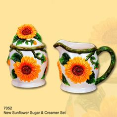 "Features:  -Comes with a fine gloss finished coating.  -Yellow sunflower design.  -Material: Ceramic. Dimensions:  -Sugar with lid dimensions: 5"" H x 3.75"" W x 3.75"" D.  -Creamer dimensions: 4"" H x 6"""