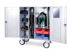 Ideal for riders with more equipment, this saddle box has four plastic containers and big solid wheels and a mirror. It is crafted from aluminum or steel. Tack Box, Plastic Containers, Saddles, Locker Storage, Furniture, Equestrian, Wheels, Home Decor, Horses