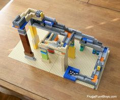 Challenge kids to build an awesome LEGO marble run with ramps, doors, and other elements with moving parts. They'll learn a ton of physics in the process! Lego Math, Lego Craft, Lego Duplo, Lego Projects, Projects For Kids, Diy Pour Enfants, Lego Challenge, Lego Activities, Camping Activities