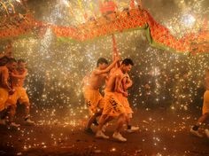 People perform a fire dragon dance in the shower of molten iron spewing firework-like sparks to celebrate the Lantern Festival, in Meizhou, Guangdong province, China March REUTERS/Stringer Dragon Dance, Fire Dragon, Dancing In The Shower, China Today, Sea Sculpture, Lantern Festival, Hindu Festivals, Happy Holi, Weird Pictures