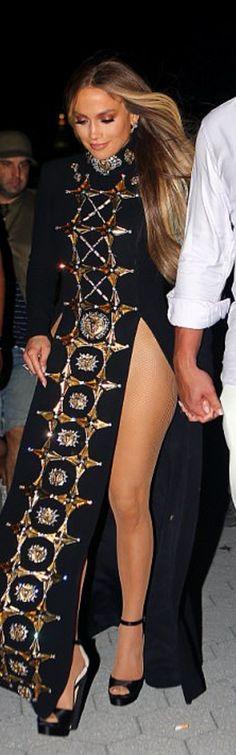 Who made  Jennifer Lopez's black slit gown and diamond jewelry?