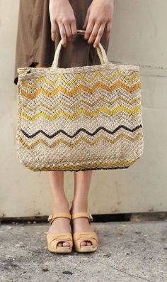 Maybe the perfect summer tote: the muted zigzags on this jute shopper recall ocean waves and sunsets at the beach.