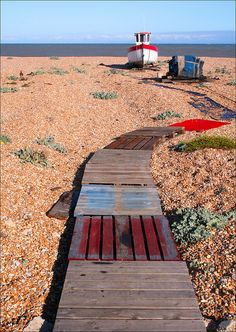 Walkway to the Little Boat Scene from the beach at Dungeness in Kent. By Canis Major Places To Visit Uk, Romney Marsh, Kent Homes, Flotsam And Jetsam, Famous Landmarks, Coastal Art, Walkway, Aerial View, Brighton