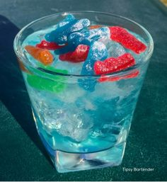 DRUNK LIL KIDS  1/2 oz. (15 ml) Raspberry Vodka  1/2 oz. (15 ml) Green Apple Vodka  1/2 oz. (15 ml) Island Punch Pucker  1/2 oz. (15 ml) Peach Schnapps  Splash of Blue Curacao  1 oz.(30 ml) Lemonade  2 oz. (60 ml) Lemon Lime Soda  Sour Patch Kids