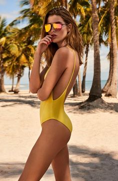 Mellow yellow. This one-piece textured swimsuit with cut out back makes a colorful statement