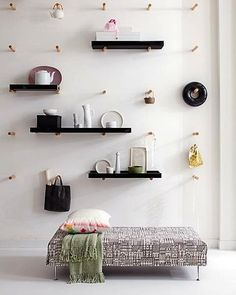 Pegboard wall with shelves   from VT Wonen | Remodelista