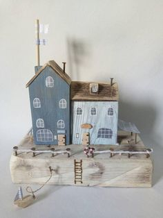 Made from reclaimed wood, driftwood and metal, this little Gift Shop and Tea Shop sit side-by-side on a sanded piece of reclaimed wood. Theres striped awning, display boxes, wooden doors, signage Driftwood doors with tiny Driftwood handles cafe benches and seats with a striped