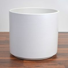 Round, white, pottery planter. Perfect for the Children/Creativity Area and the Travel/Helpful People Area.