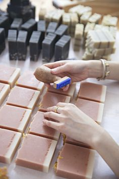 Etsy Design Award winner Mei Ong from Vice and Velvet hand-stamping each handmade soap. via WeeBirdy.com.