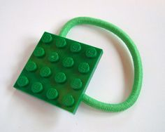 A fun fashion statement. Its hip to be square, but better to build.    Choose from a rainbow of colors.    Kelley Green LEGO® plate is transformed