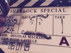 """SHERLOCK (BBC) ~ """"Element-hairy, my dear Watson!"""" Mark Gatiss (co-creator, writer, who also plays Mycroft Holmes) tweeted along with this photo of a clapper (sporting John Watson's mustache) on January 6, 2015, the first day of filming the pre-S4 special"""