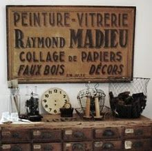 old sign love, plus check out that piece of furntiure and all the goodies on top!