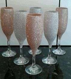 You are looking at hand glittered wine / champagne glasses in silver and sand. They are not dishwasher proof but can be warm hand washed ! Orders will be boxed and glasses will be bubble wrapped. Fun Wine Glasses, Glitter Wine Glasses, Wedding Wine Glasses, Decorated Wine Glasses, Wedding Champagne Flutes, Hand Painted Wine Glasses, Wine Glass Crafts, Bulk Order, Tumblers