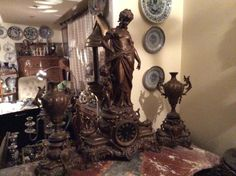 French spelter clock group , signed by H. Moreau ..