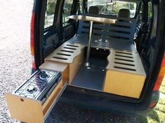 Small van camper conversion made from wood