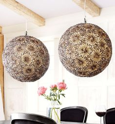 lovely sphere lights- covered in sliced sea shells that are arranged in a floral pattern
