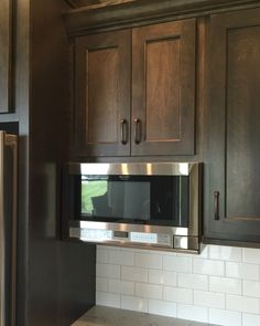 An Over The Counter Sharp Microwave Installed In A Bettendorf Ia