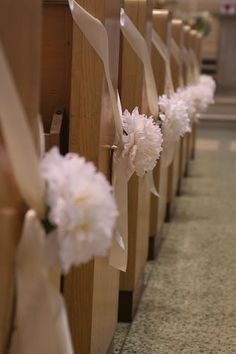 simple pew decor - nice - simple. Could make tissue paper flowers to save additional money.