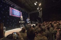 https://flic.kr/p/PHMRmq | 161205-D-PB383-031 | Scarlett Johansson and Chris Evans perform for service members during the USO Holiday Tour at Incirlik Air Base, Dec. 5, 2016. Marine Gen. Joseph F. Dunford, Jr., chairman of the Joint Chiefs of Staff, and USO entertainers, will visit service members who are deployed from home during the holidays at various locations across the globe. This year's entertainers included actor Chris Evans, actress Scarlett Johansson, NBA Legend Ray Allen, 4-time…