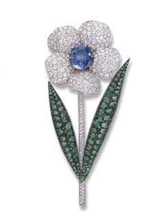 A SAPPHIRE, EMERALD AND DIAMOND FLOWER BROOCH, BY MICHELE DELLA VALLE