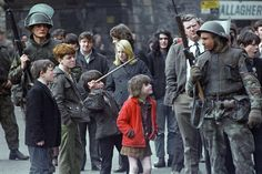 Local children taunt a British soldier as he stands guard in Londonderry, Northern Ireland on April 13, 1972, after an explosion in the city center. (AP Photo/Michel Lipchitz) Ref #: PA.11926367