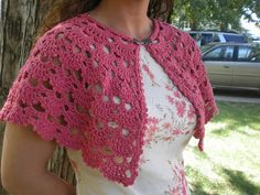 I can do this with a wider neckline, ribbon tie, longer, and with an extra, lacy edging of some sort on it. Ravelry: Coral Capelet pattern by Edie Eckman