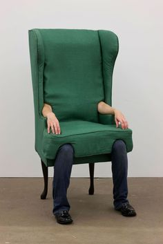 """Jamie Isenstein, Arm Chair, 2006. Wood, metal, nylon, raw cotton, linen, jeans, shoes, hardware, human arms, human legs, or """"Will Return"""" sign. Dimensions variable. Courtesy the artist and Andrew Kreps Gallery, New York. Photograph by Thomas Mülle"""