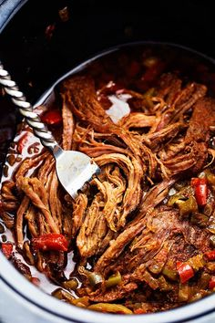 Flank steak that is rubbed in spices and slow cooks with peppers, jalapeño, and onions all day to tender and juicy perfection!  This recipe is easy and will become a family favorite!  I made these carnitas when I first started my blog.  They were an instant family favorite.  But…  my photography needed a makeover.  Here …