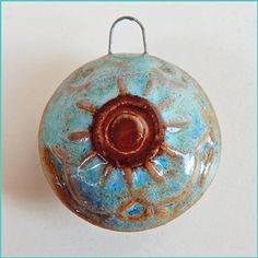 I love love love this pendant. Always love the sun in designs, and the colors draw me in. -- Pendant made of porcelaine The pendant been glazed on both…