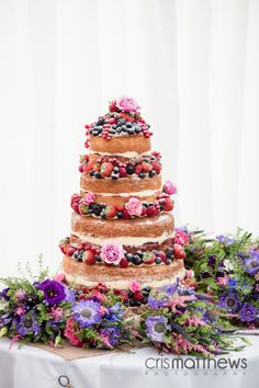 Stunning Naked #Wedding Cake I love this. 1) DIY anyone??? 2) cheaper (if rather a nicer honeymoon or house) 4) choose a pound, yellow or firm angel cake and a light frosting. Maybe have a bowl or two of extra frosting/berries! Tiered cake $100. Wedding cake same size $400. If rather a naked one and a nicer dress vaca or house deposit.