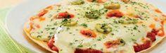 Uma ótima ideia para fazer umapizza!  Ingredientes    1 ovo 50g de manteiga amolecida (textura de pomada) 1 1/2 xícara de farinha de trigo 1 colher (sobremesa) de fermento