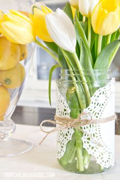 Simple Easter Centerpiece:  For the easiest DIY vase of all time, use twine to wrap a doily around a Mason jar.