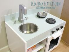 Make an adorable play kitchen with sink, stove, oven, fridge and microwave from an old pair of nightstands with a great tutorial from littleredwindow.com!