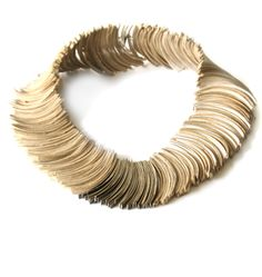 The original Kleopatra collier by ANNIINA DUNDER-FI 2005. Made of recycled cardboard and sterling silver.