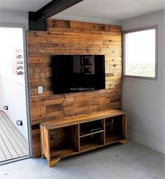 The pallet TV cabin at wall idea is great not only because it allows a place to fix the TV, but it will also adorn the wall. There are spaces in which the items linked to the TV can be placed and there is no need to place something special to place them near the TV.