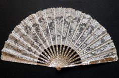 Late 19th century mother-of-pearl fan with white lace leaf.