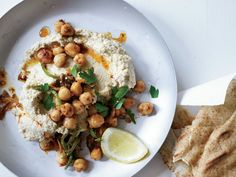 Hummus with Tahini & Spicy Chickpeas | Michael Solomonov makes his signature hummus with a generous amount of tahini. He tops the dish with warm chickpeas fried with jalapeño, cumin and Aleppo pepper.