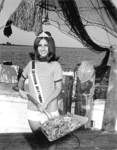 Miss Florida Seafood holding a shovelful of shrimp at the seafood festival c.1970