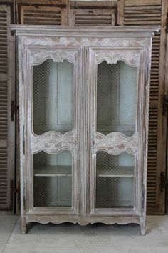 A very decorative late 18th Century French oak armoire - later bleached and limed and with wire-mesh doors