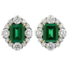 Colombian Emerald Diamond Gold Platinum Earrings | From a unique collection of vintage stud earrings at https://www.1stdibs.com/jewelry/earrings/stud-earrings/