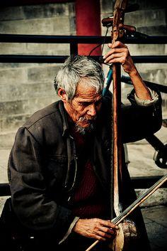 Street musician with erhu ~ China