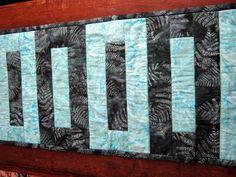 Modern Quilted Table Runner in Batik Island Blues. $20.00, via Etsy.