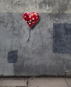 "Banksy, ""Better Out Than In,"" 2013. New York. ""Now the heart stands wounded and bandaged in New York. It is still both practicing and defying the laws of physics. What might have caused the wound; who fixed it up; why won't it fly away; and why is it still within reach? The girl is gone!"""