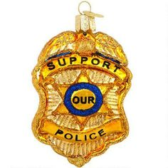 Gold Police Badge Glass Ornament, from Bronner's Christmas Wonderland. I love this company.