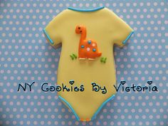 Baby Dino on Onesie, see more pictures @ : https://www.facebook.com/pages/NY-Cookies-By-Victoria/390369164337852?sk=photos_albums