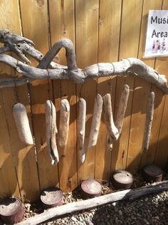 """""""This is a picture of our Musical Marimbra that we made put of drift wood. Each piece of wood makes a different sound depending in the density of the wood. The drums at the bottom are made from coffee cans."""" - My Intentional Play                                                                                                                                                                                 More"""