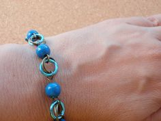 Bracelet #7 by ACBeads, via Flickr  Beaded chainmaille bracelet made from gorgeous aluminium jump rings.