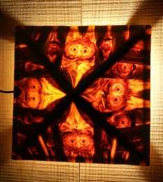 Wooden lights depicting the inner beauty of a pine. Amazing use of knots of pine in the formation of animal looking (owl) figures. During day time they look to be mosaic patterns and when energized with warm white light transformed into colourful unimaginable creatures.
