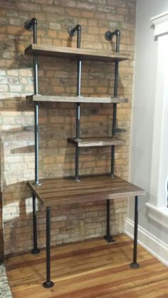 DIY industrial style desk made with butcher block wood and painted galvanized pipe, floor flanges, and elbows. Lag bolts used through flanges for disassembly. #industrialfurniture #industrialdesk #DIYindustrial